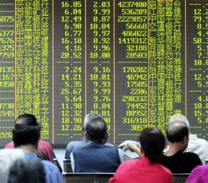 Investors look on as Chinese Stocks continue to fall. In China, Green numbers means that the stock is falling (Image Courtesy of BBC)