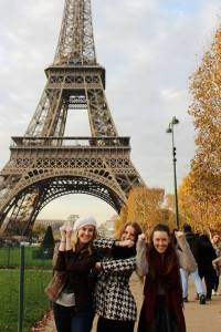 Mackenzie and her friends in Paris, making the ISU hand signs.