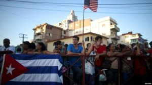 Excited Cubans await the embassy's opening. (Image Courtesy of BBC)
