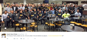 The Mizzou Football team stood together in solidarity (Image Courtesy of the BBC)
