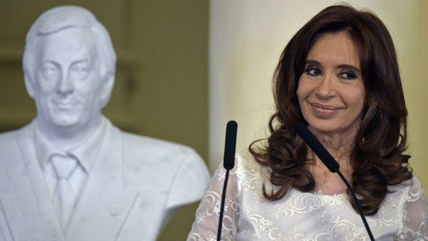 Fernandez, with bust of her husband, Nestor Kirchner behind her
