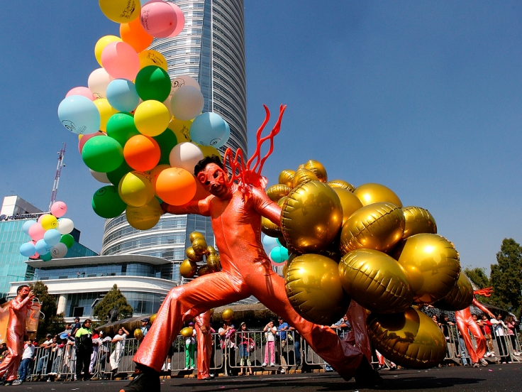 """An actor performs on the streets during the """"Three Kings Day"""" festival in Mexico City"""