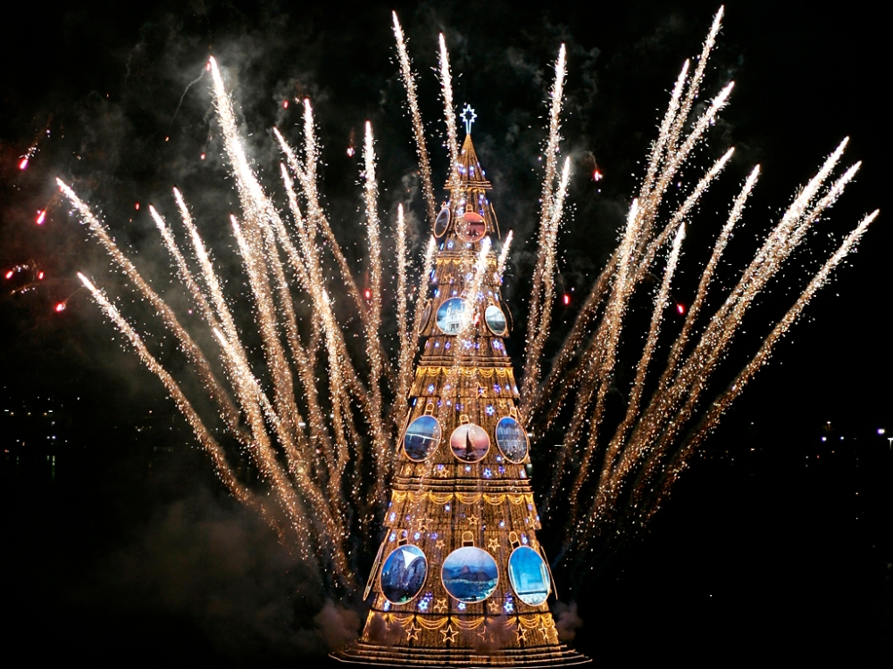 Fireworks explode near traditional Rio de Janeiro Christmas tree during official lighting ceremony at Rodrigo de Freitas lake
